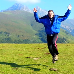 Jumping over a mountain! And enjoying the view in the Pyrenees.